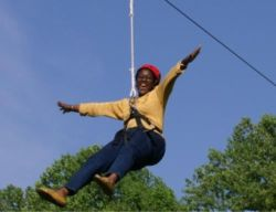 Another happy person enjoying the zip line at Smokey Glen Farm